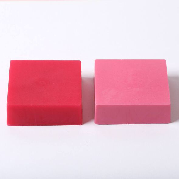 Example of mica in clear melt and pour soap on the left and white melt and pour soap on the right.