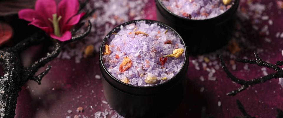 lavender colored bath tea in a black container