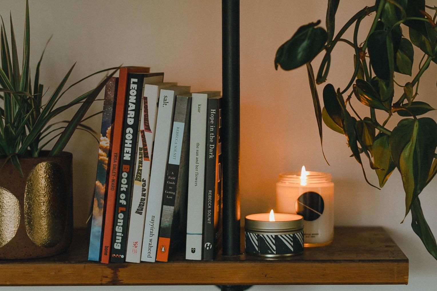 soy wax candles on a bookshelf
