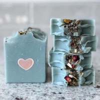 teal soaps with a pink heart