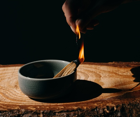 lit incense in a bowl