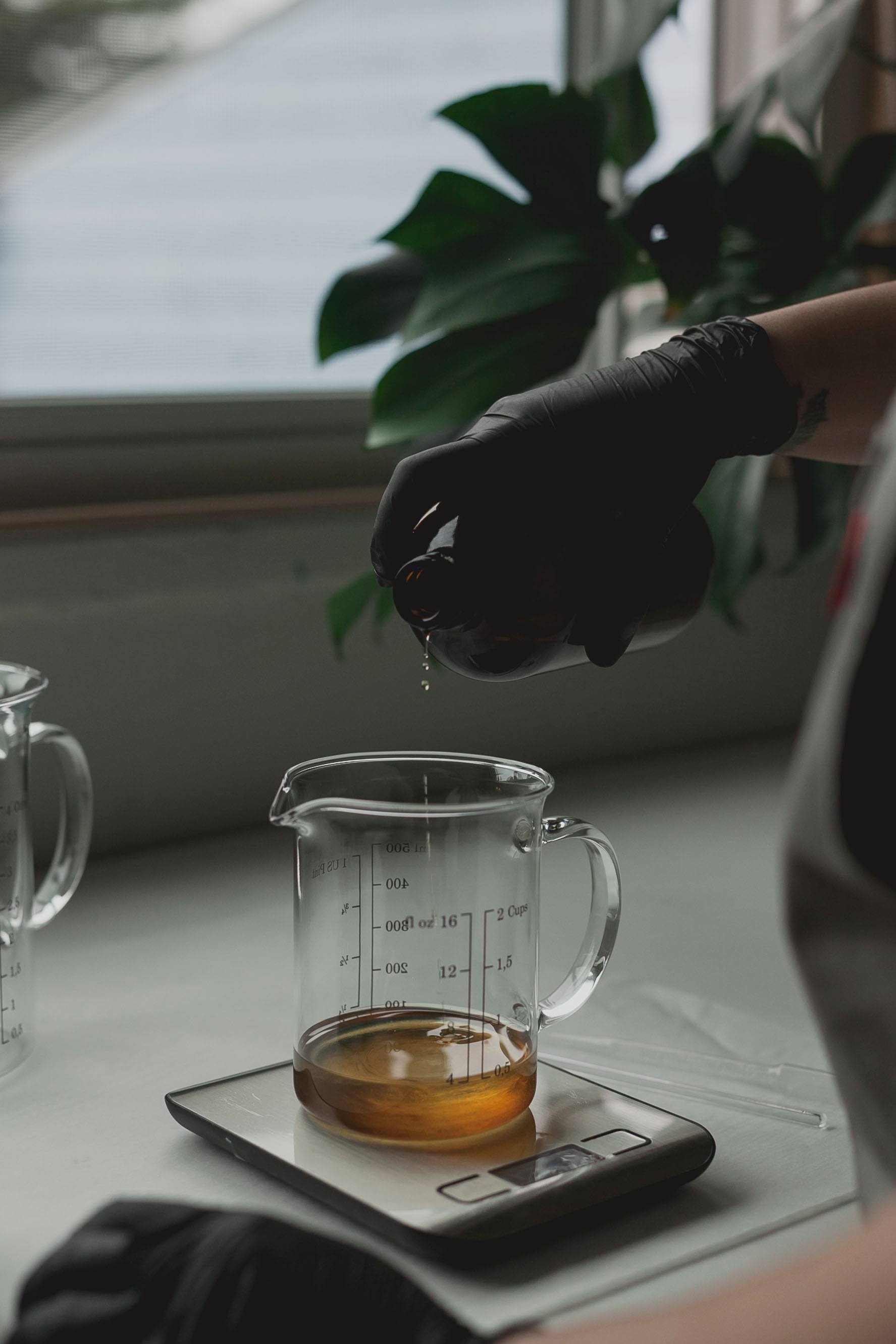 measuring fragrance for candles