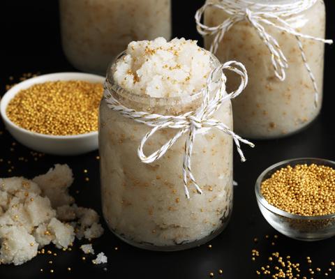 white sugar scrub with gold bursting beads