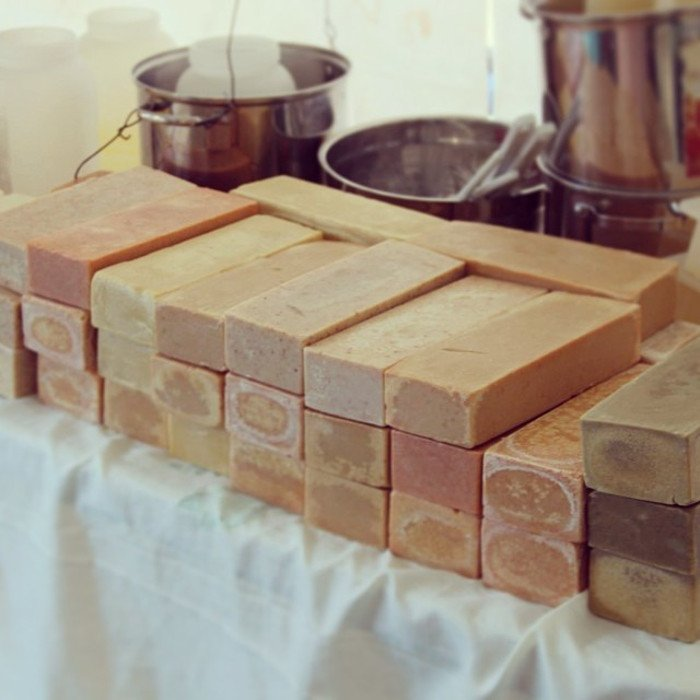 a stack of cold process soap for donation