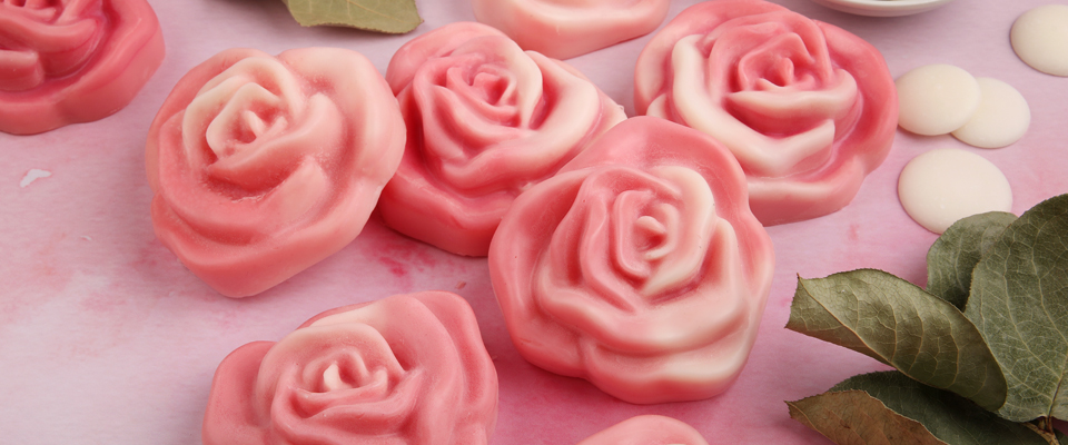 pink and white rose shaped lotion bars