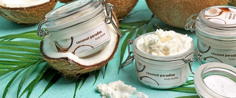 containers of body butter with tropical background