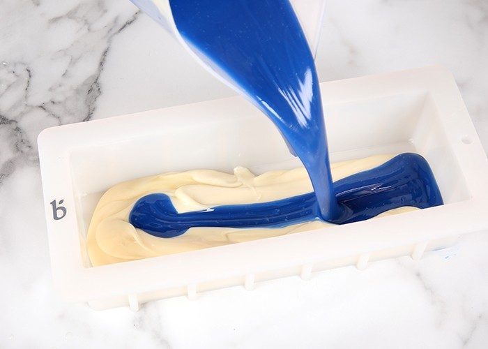 blue batter poured into mold